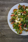 Rocket salad with fig mozzarella roasted bread Royalty Free Stock Photos