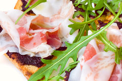Rocket salad and ham sandwich stock photography