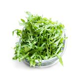 Rocket salad leaves in glass bowl isolated on white. Rocket  salad leaves in glass bowl isolated on white stock photo