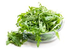 Rocket salad leaves in glass bowl isolated on white. Rocket  salad leaves in glass bowl isolated on white royalty free stock photos