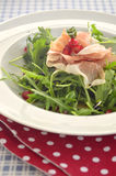 Rocket salad with parma ham and pomegranite seeds Stock Photos
