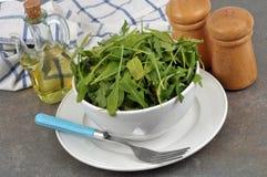 Bowl of rocket salad close up stock images
