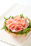 Rocket salad and sliced ham Royalty Free Stock Image
