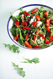 Rocket salad with strawberries, kalamata olives and goat cheese Stock Photo