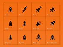 Rocket ship icons on orange background Royalty Free Stock Image