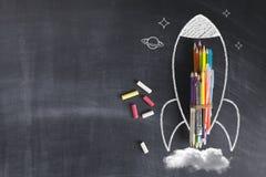 Rocket Sketch On Blackboard photo stock