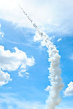 A rocket in the sky. A rocket floats to go up the sky at day time Royalty Free Stock Photo