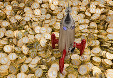 Rocket standing on a lot of Bitcoins Stock Images