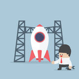 Rocket startup, Businessman build space shuttle Royalty Free Stock Photo