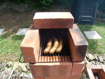 Rocket Stove With Three Sausages Fotos de Stock Royalty Free