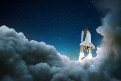 Rocket takes off in the starry sky. royalty free stock photography