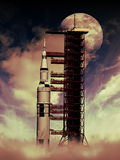 Rocket to the Moon. The Saturn V rocket in its launchpad, with the Moon at the background Stock Photo