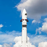 Rocket Vostok and blue sky with clouds Royalty Free Stock Image