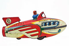 Rockets. Old rocket toy with pilot on white Royalty Free Stock Images