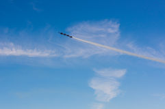 Rockets. In white cloud leaving contrails Royalty Free Stock Photo