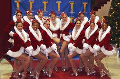Rockettes. The Rockettes, Radio City`s own dance troupe don their Christmas season holiday apparel and pose at Madame Tussauds New York at 234 West 42nd Street stock photography