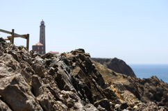 Rockfall with fence on a lighthouse Royalty Free Stock Photos
