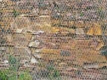 Rockfall prevention. Rockfall nets at Kanetvlei in the Karoo SA Royalty Free Stock Image