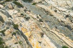 Rockfall protection netting on cracked rocks Royalty Free Stock Image