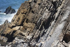 Rockfall to the sea. A detailled rockfall falling in to the sea Stock Image