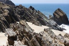 Rockfall to the sea. A detailled rocks near the sea Royalty Free Stock Photo