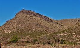 Rockhound State Park in New Mexico. A cross stands at the top of a mountain at Rockhound State Park just east of the town of Deming in southern New Mexico stock photo