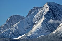 Rockies First snow. A blue majestic snow covered mountain Royalty Free Stock Images
