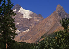 Rockies landscape. Snow patched Rocky Mountain landscape on a clear blue sky day Royalty Free Stock Photos