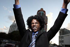 Rockin businessman. Young businessman in a rocker pose Royalty Free Stock Images