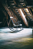 The rocking armchair on attic floor of Round Tower in Copenhagen Stock Images