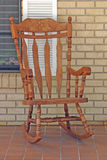 Rocking Chair. Full view of wooden rocker on porch stock photo