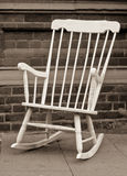 Rocking chair. Lovely monochrome image of a white rocking chair Royalty Free Stock Image
