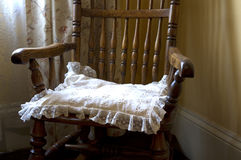 Rocking chair. Cushion on wooden rocking chair Royalty Free Stock Image