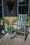 The Rocking Chair. A taste of Americana. A rocking chair on a porch Royalty Free Stock Photo