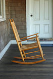 Rocking Chair. A rocking chair on the porch of a beach house stock photo