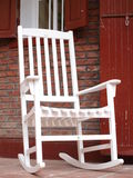 Rocking chair. White rocking chair before the red wall Stock Images
