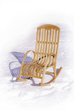 Rocking chair. Wooden rocking chair in the snow. Winter sunny day Stock Photography