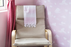 Rocking chair in a baby room Royalty Free Stock Photos