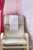 Rocking chair in a baby room Royalty Free Stock Image