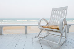 Rocking Chair on the beach Stock Photos