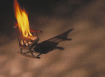 Rocking chair on fire Stock Photography