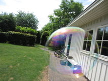 Rocking chair through floating soap bubble Royalty Free Stock Photos