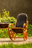 Rocking chair in the garden Royalty Free Stock Images