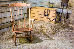 Rocking chair and hay stack Stock Images