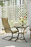 Rocking chair and little table. On the veranda Stock Image