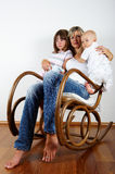 Rocking chair : mother and son and daughter Stock Photos