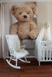 Rocking chair in nursery room stock photo