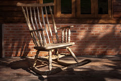 Rocking Chair in Old Cabin. The old rocking chair under the shadow of the morning Stock Photos