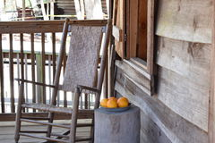Rocking Chair on porch with oranges. Simplicity and Rocking Chair/ Oranges on display at the Knap In Prehistoric  Arts Festival in Ocala, Florida on Feb. 21 Stock Images