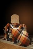 Rocking-chair with plaid and book Royalty Free Stock Photos